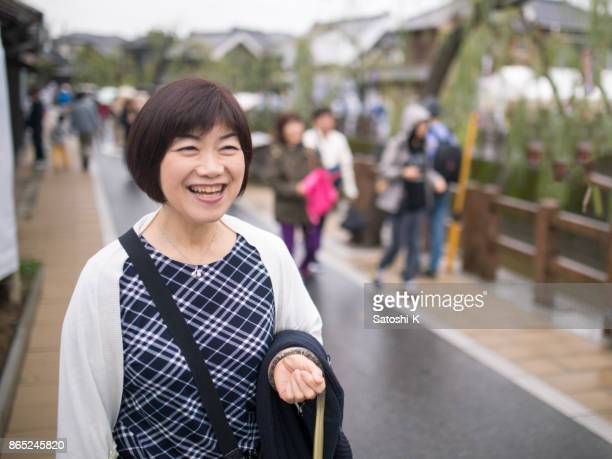 Japanese woman walking in historical Japanese town