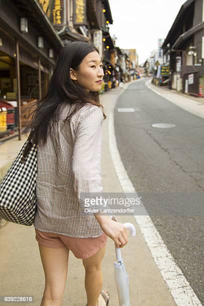 Japanese woman walking in Narita, Japan