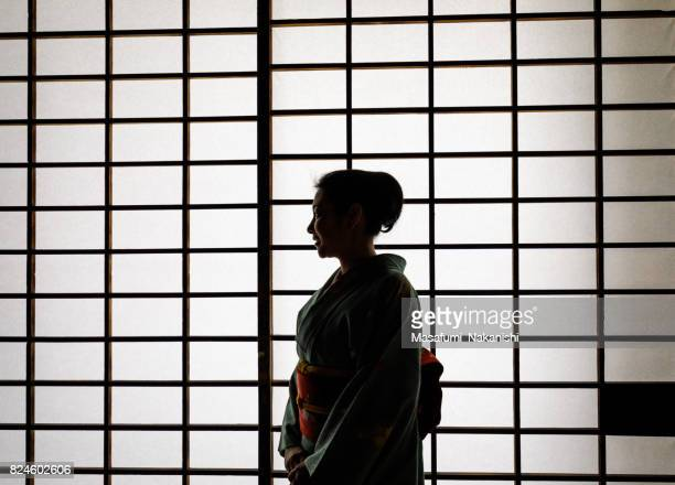 japanese woman wearing a kimono in a japanese style room - wabi sabi stock pictures, royalty-free photos & images