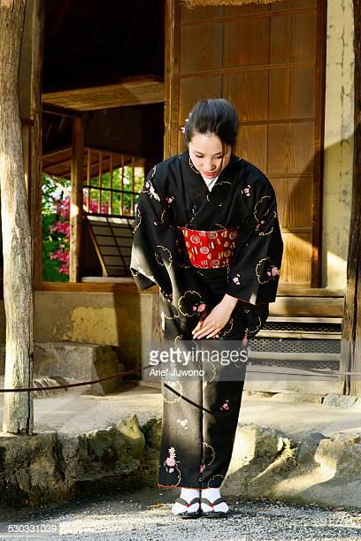 Japanese woman wearing a kimono looking down