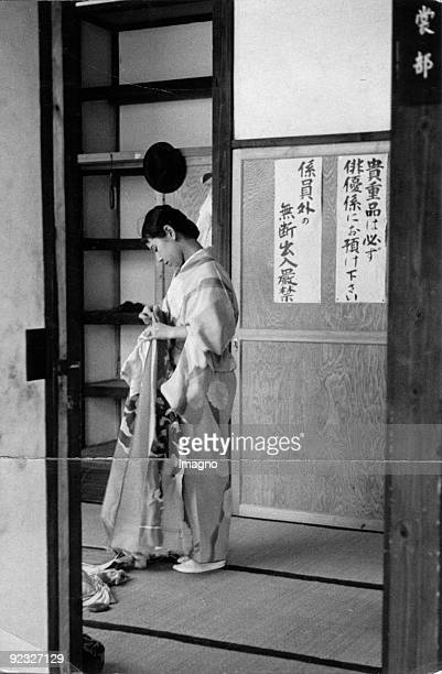 Japanese woman wearing a Kimono The sign says 'It is not allowed to enter for unauthorised people' Photograph Japan Around 1930