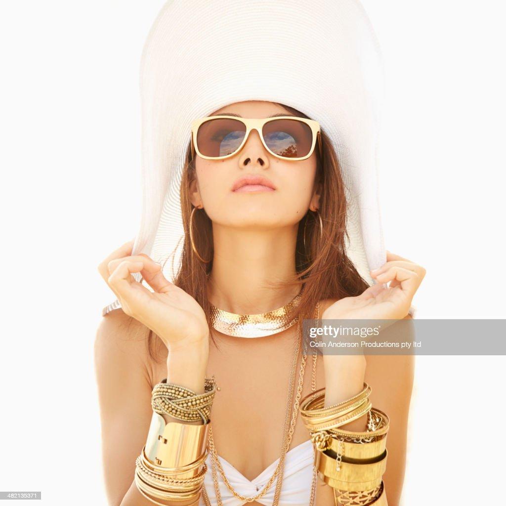 Japanese woman wearing gold bracelets and sunglasses : Stock Photo
