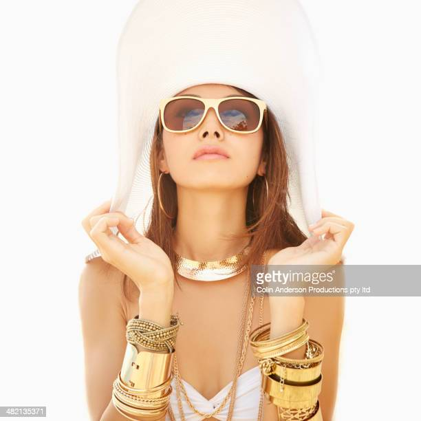 Japanese woman wearing gold bracelets and sunglasses