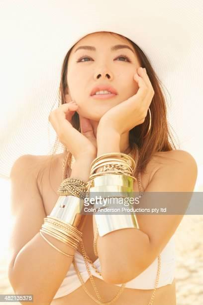 Japanese woman wearing gold bracelets