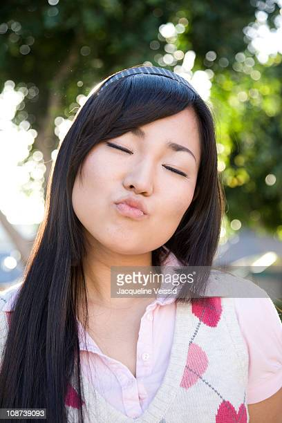 Japanese woman with kissing expression