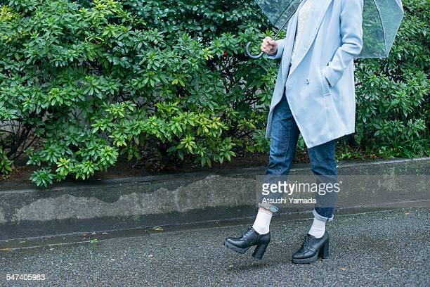 Japanese woman with umbrella, low section