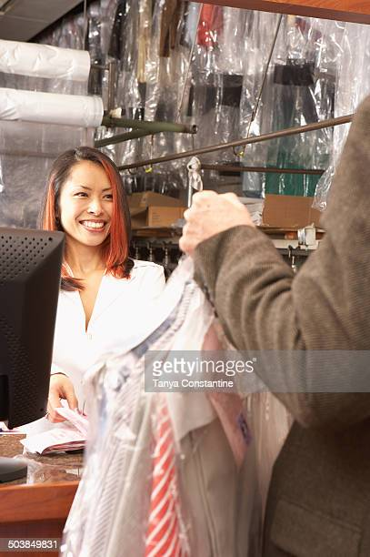 Japanese woman working in dry cleaners