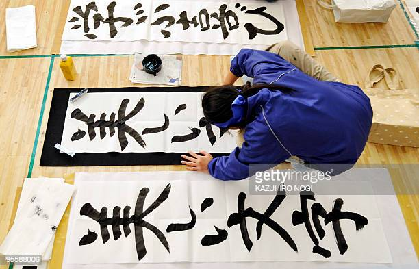 A Japanese woman writes calligraphy during the 46th annual calligraphy contest in Tokyo on January 5 2010 to help mark the start of the new year A...