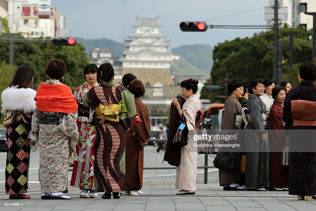 japanese women dressed in colorful traditional costumes called kimono stand during the kimono festival at the - Traditional Castle 2016