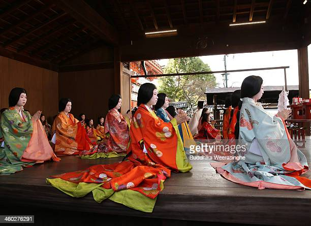 Japanese women dressed in Heian Period costumes participate in the first ' Karuta' card game of new year at Yasaka Shrine on January 3 2014 in Kyoto...