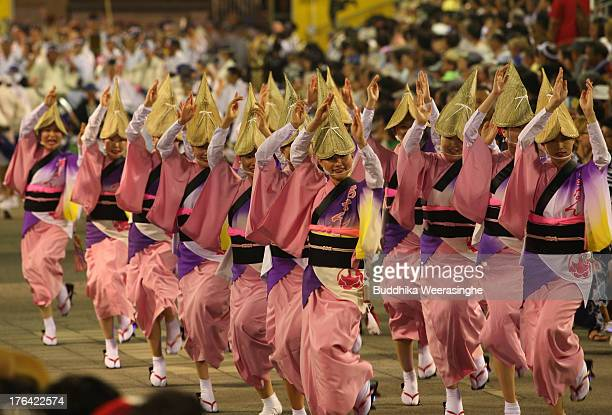 Japanese women dressed in traditional costume perform AwaOdori dance during the annual 'Awa odori' or Awa Dance Festival on August 12 2013 in...