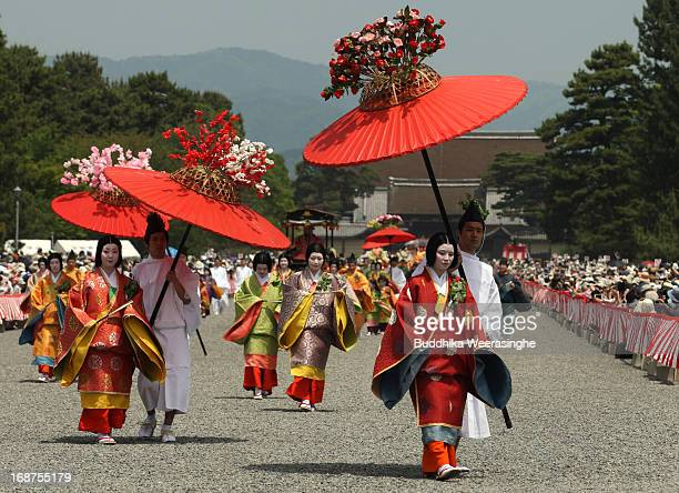 Japanese women dressed in traditional costumes walk in the procession of the Aoi Festival at the Imperial Palace on May 15 2013 in Kyoto Japan Aoi...