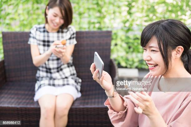 Japanese women enjoying selfie with sweets in the roof garden
