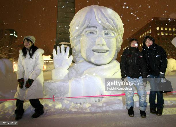 Japanese women gather in front of the large snow statue of South Korean actor Bae YongJoon at The 56th Sapporo Snow Festival on February 10 2005 in...