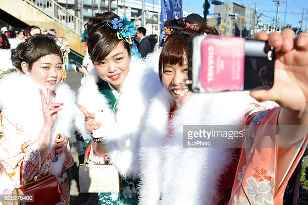 Japanese women in kimonos pose for pictures after a ceremony celebrating Coming of Age Day in Tokyo January 12 2015 Age twenty is considered the...