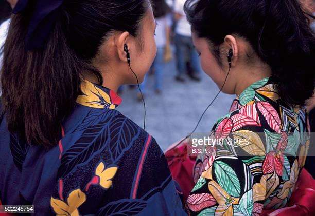 Japanese Women Listening to Earphones