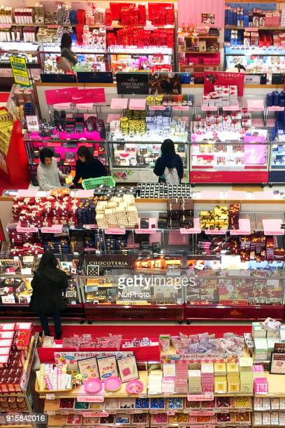 Japanese women look at chocolates displayed at a department store ahead of Valentine's Day in Tokyo February 8 2018