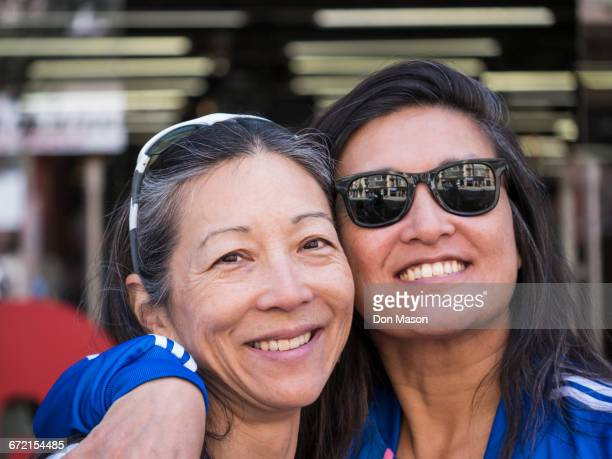 japanese women posing cheek to cheek - sister stock pictures, royalty-free photos & images