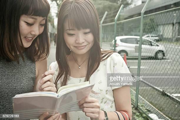 Japanese women reading diary,smiling