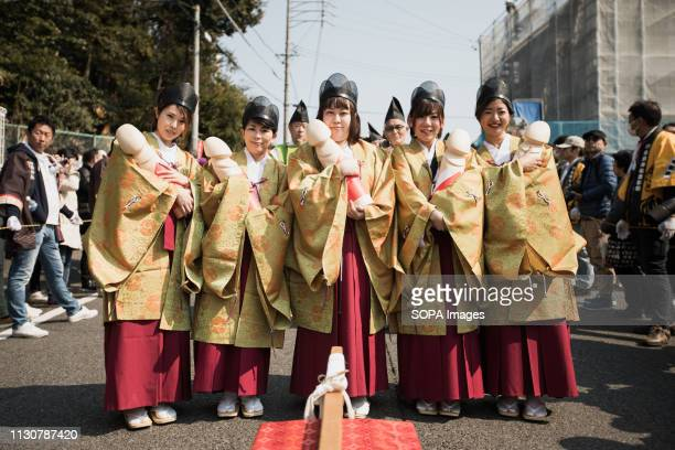 Japanese women seen holding replicas of phalluses during the festival Honen festival is a traditional famous festival in Tagata Jinja Shrine komaki...