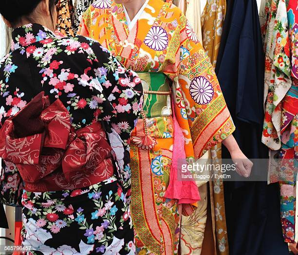 Japanese Women Trying On Kimono