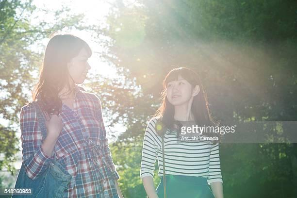 Japanese women walking in park,smiling