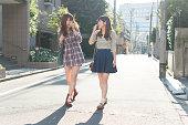 Japanese women walking on street,smiling