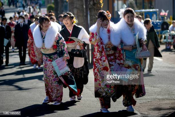 Japanese women wearing kimonos attend their Coming of Age Day celebration ceremony at Toshimaen amusement park in Tokyo Japan January 14 2019Japanese...