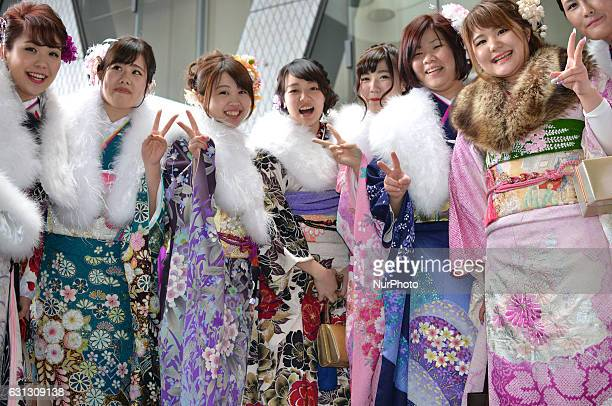 Japanese women wearing kimonos pose for pictures as they attend a Coming of Age Day celebration ceremony at an amusement park in Tokyo January 9 2017
