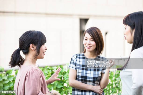 Japanese women who enjoy talking in the roof garden
