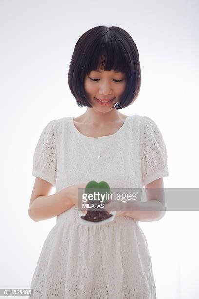 Japanese women with heart-shaped plant