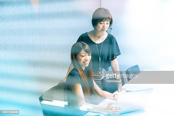 japanese women working with laptop