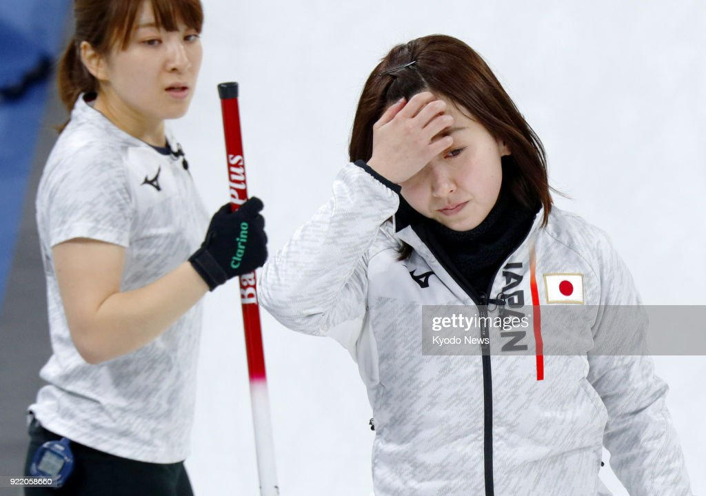 Japanese women's curling team skip Satsuki Fujisawa (R) reacts after failing a shot against Switzerland during a round-robin session match in Gangneung, South Korea, at the Pyeongchang Winter Olympics on Feb. 21, 2018. At left is her teammate Yumi Suzuki. ==Kyodo