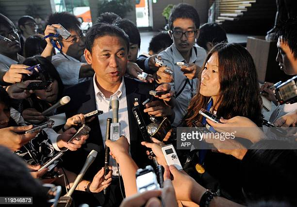 Japanese women's national football team head coach Norio Sasaki and player Homare Sawa answer questions from reporters after they met Japanese Prime...