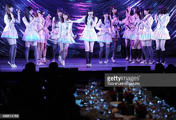 Japanese women's pop group AKB48 led by Rino Sashihara performs onstage during a gala dinner of the ASEANJapan commemorative summit meeting hosted by...