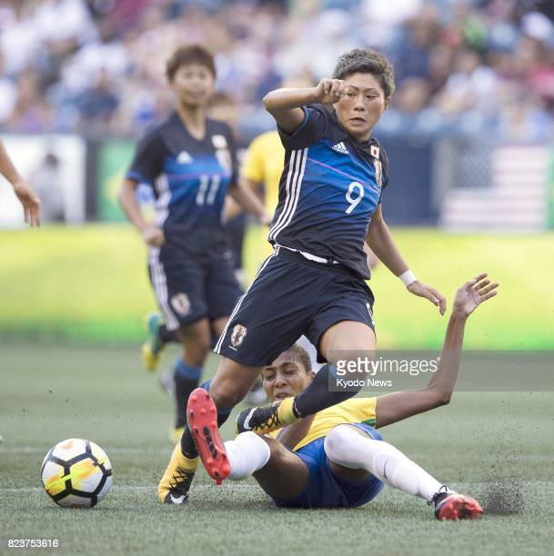 Japanese women's soccer player Kumi Yokoyama vies for the ball during the second half of a game against Brazil at the Tournament of Nations a...