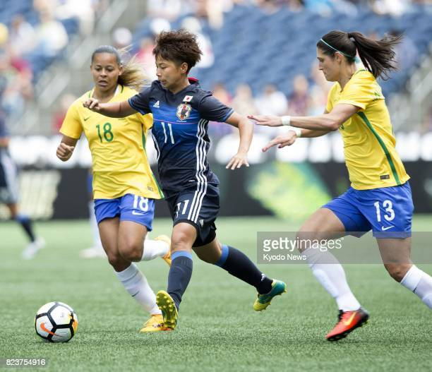 Japanese women's soccer player Mina Tanaka vies for the ball during the first half of a game against Brazil at the Tournament of Nations a fourteam...