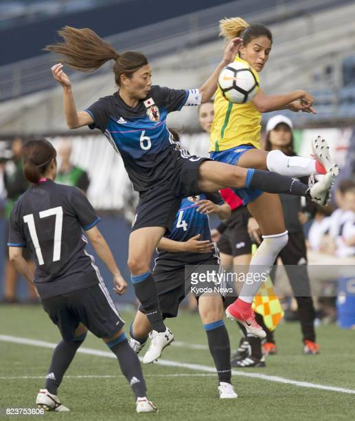 Japanese women's soccer player Rumi Utsugi vies for the ball during the first half of a game against Brazil at the Tournament of Nations a fourteam...