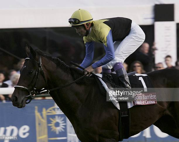 Japanese wonder horse Deep Impact and jockey Yutaka Take take part in the parade beforeThe Prix De L'Arc De Triomphe run at Longchamp Racecourse on...