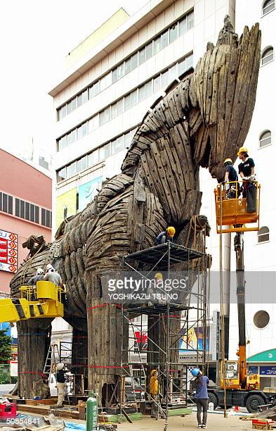 Japanese workers reassemble an 11meter tall and 14meter long Trojan Horse which was used in the American movie 'Troy' in Tokyo 19 May 2004 for the...