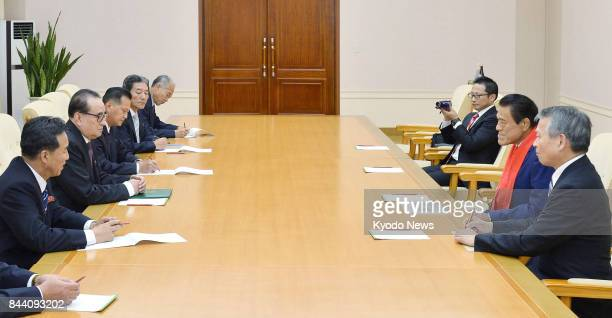 Japanese wrestlerturnedlawmaker Antonio Inoki and Ri Su Yong a vice chairman of the Workers' Party of Korea who formerly served as foreign minister...
