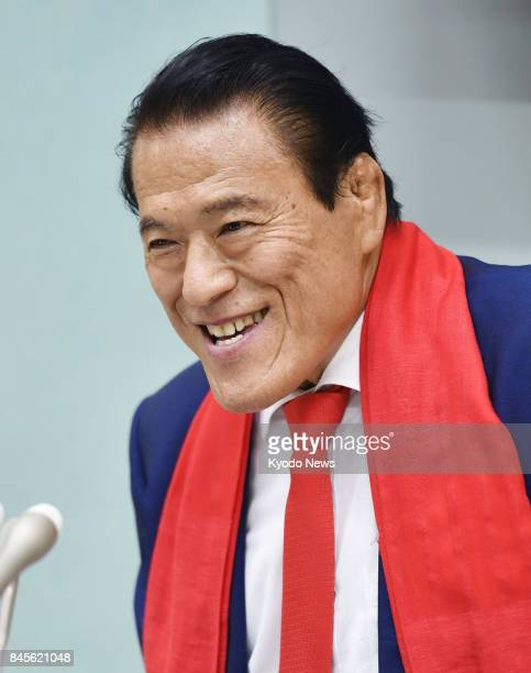 Japanese wrestlerturnedlawmaker Antonio Inoki speaks to reporters at Tokyo's Haneda airport on Sept 11 2017 Inoki who met with Ri Su Yong a vice...