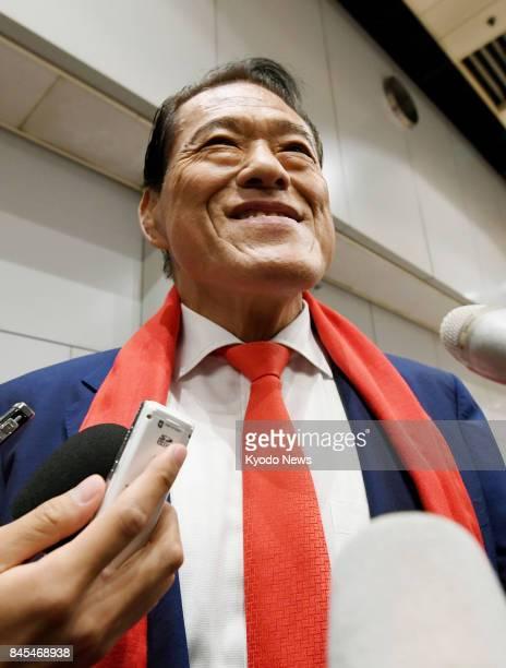 Japanese wrestlerturnedlawmaker Antonio Inoki speaks to reporters upon his arrival at Beijing's international airport on Sept 11 on his way back to...