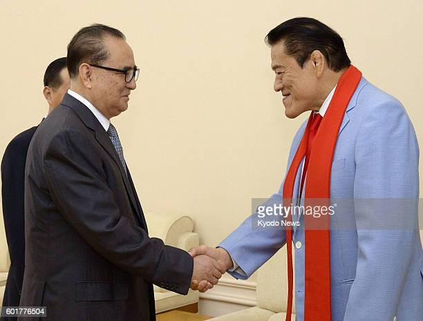 Japanese wrestlerturnedparliamentarian Antonio Inoki shakes hands with North Korea's top official in charge of foreign affairs Ri Su Yong ahead of...