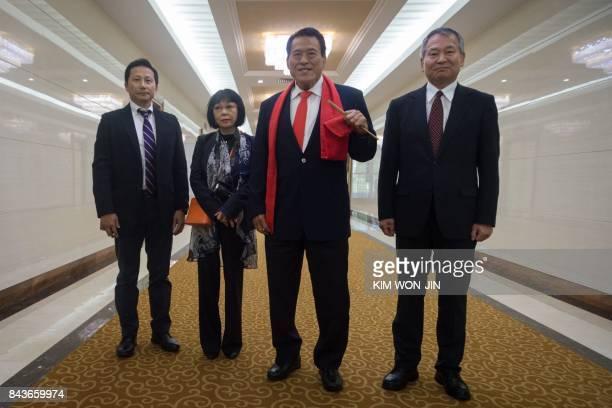 Japanese wrestlerturnedpolitician Kanji 'Antonio' Inoki arrives at Pyongyang international airport on September 7 2017 Inoki has cultivated strong...