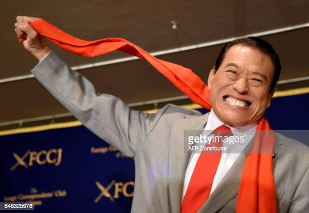 Japanese wrestlerturnedpolitician Kanji 'Antonio' Inoki display his signature pose during a press conference at the Foreign Correspondent' Club of...