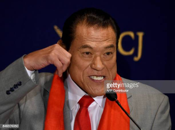 Japanese wrestlerturnedpolitician Kanji 'Antonio' Inoki gestures as he speaks during a press conference at the Foreign Correspondent' Club of Japan...