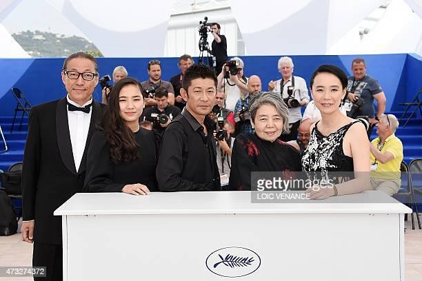 Japanese writer Durian Sukegawa actress Kyara Uchida actor Masatoshi Nagase actress Kirin Kiki and director Naomi Kawase pose during a photocall for...