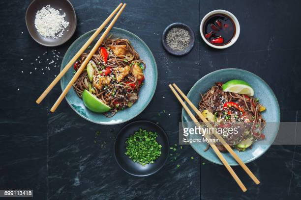 japanese yaki soba noodles with chicken and vegetables - soba stock pictures, royalty-free photos & images