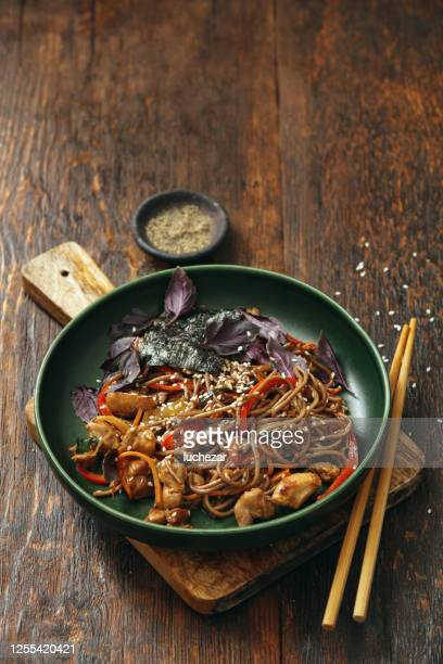 japanese yakisoba noodles with chicken and vegetables - bowl stock pictures, royalty-free photos & images